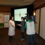 Regina 2014 NAIG Board Member Racelle Kooy speaking with Radio Canada Journalist / Racelle Kooy, Membre du Conseil d'Administration des JAAN de Regina 2014, parlant avec une journaliste de Radio Canada