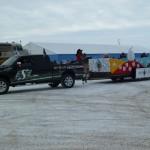The Full view of the NAIG Truck and Float / Vue complète de l'automobile et du char des JAAN
